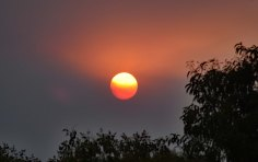 To the West, a devastating Bushfire eclipses the Sun
